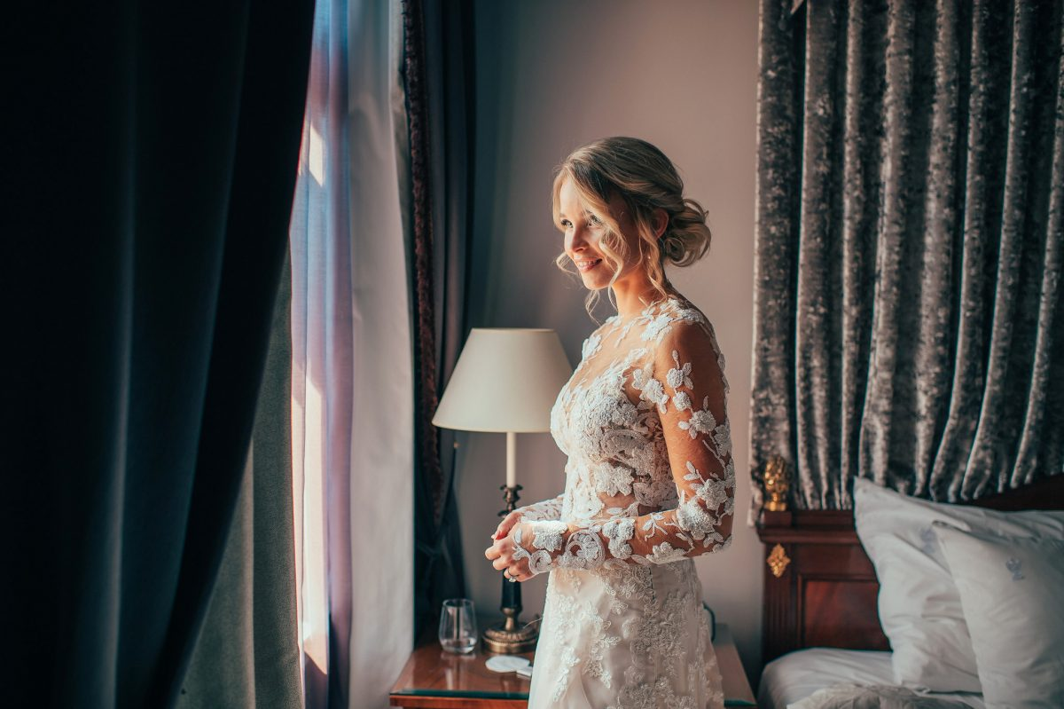 Lace sleeves wedding dress Juulia Peuhkuri Photo Henri Juvonen